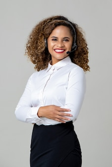 Smiling arms crossed african american woman wearing microphone