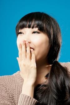 Smiling asian beauty, closeup portrait