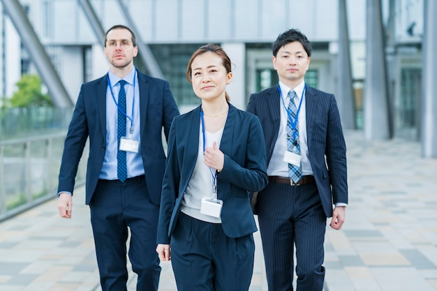 Smiling asian business woman and her business team