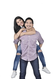 Smiling asian couple having fun together