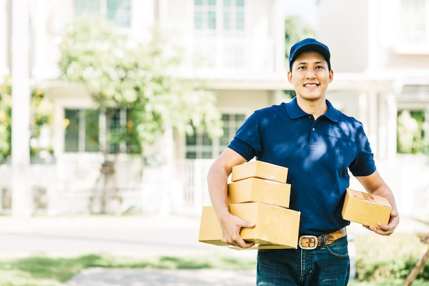 Smiling asian delivery man