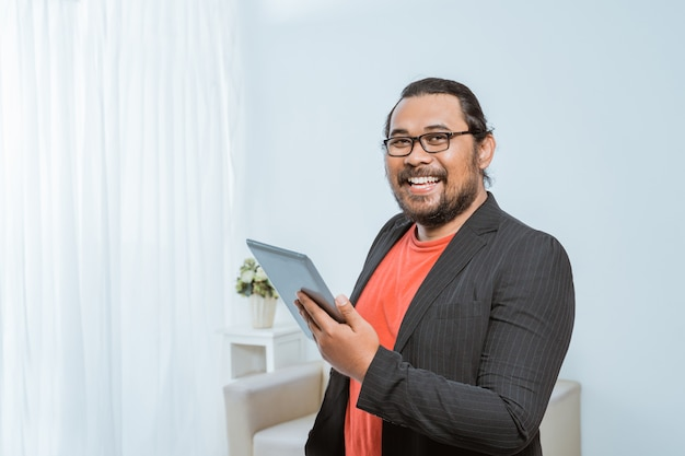 Smiling asian entrepreneur looking at camera