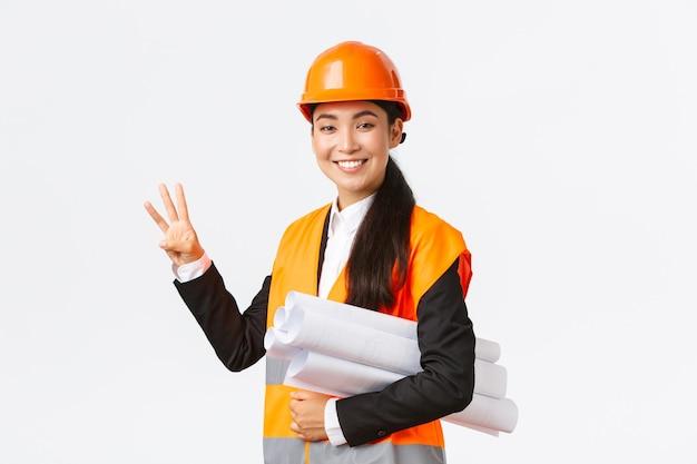 Smiling asian female architect