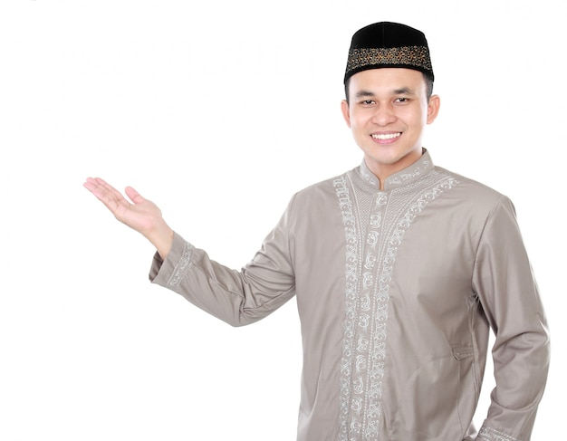 Smiling asian muslim man presenting copy space