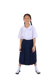 Smiling asian schoolgirl in thai school uniform standing isolated on white background. image full length with clipping path