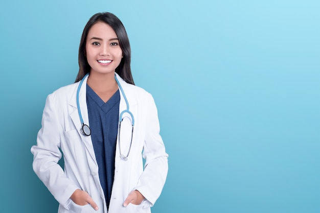 Smiling asian woman physician in a white coat