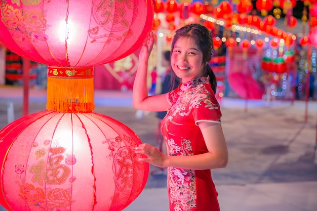 Smiling asian woman with the red lantern