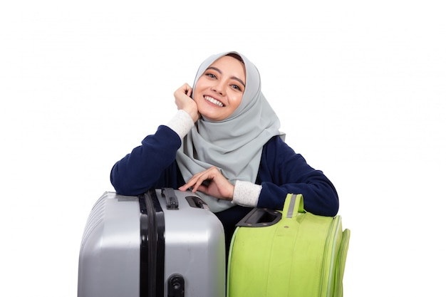 Smiling asian woman with suitccase
