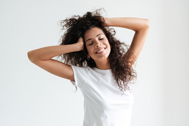 Smiling attractive woman with eyes closed