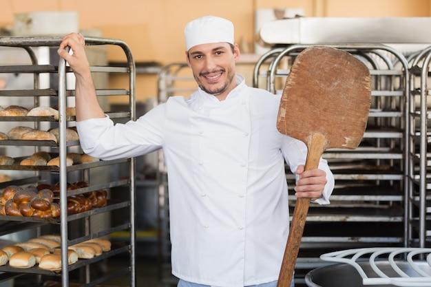 Smiling baker looking at camera