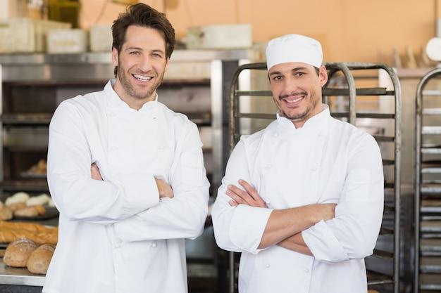 Smiling bakers looking at camera