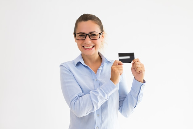 Smiling bank customer recommending new credit card