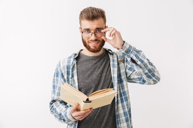 Smiling bearded man in shirt and eyeglasses holding book