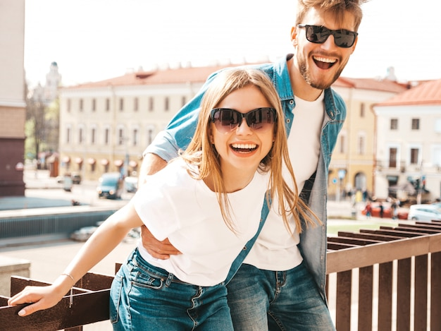 Smiling beautiful girl and her handsome boyfriend in casual summer clothes.   .