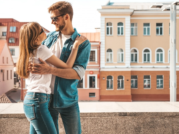 Smiling beautiful girl and her handsome boyfriend. woman in casual summer jeans clothes.    .looking at each other