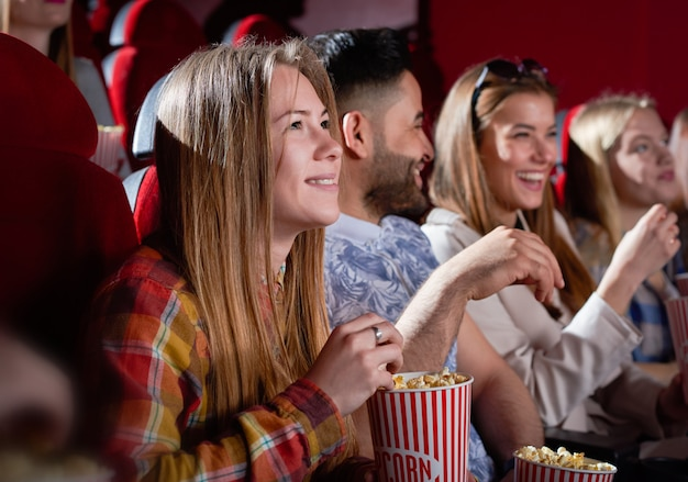 Smiling beautiful woman watching movie.