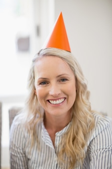 Smiling beautiful woman with party hat