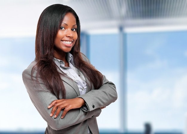 Smiling black businesswoman in her office