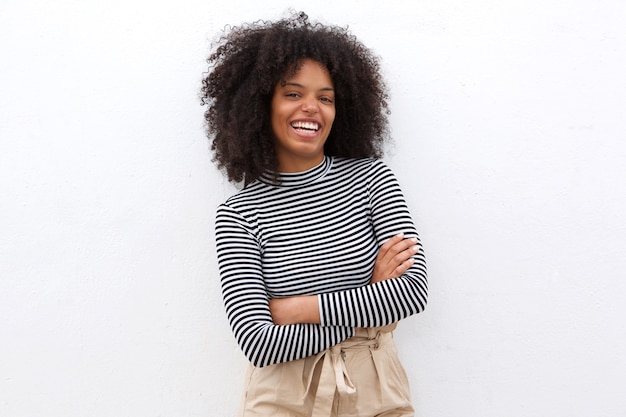 Smiling black woman in striped shirt with arms crossed