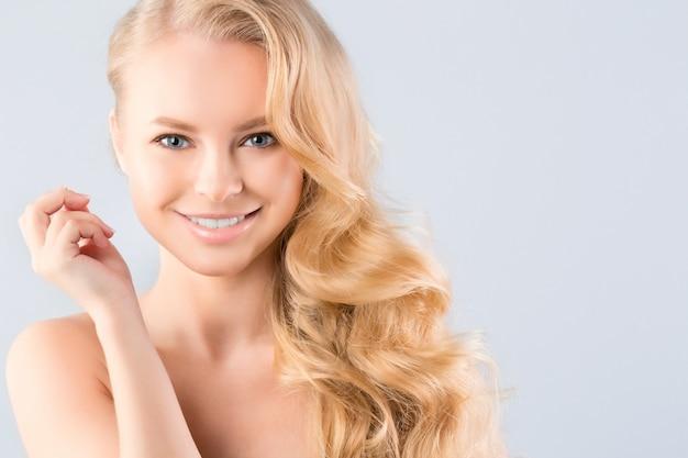 Smiling blonde posing