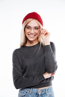Smiling blonde woman in hat and glasses looking