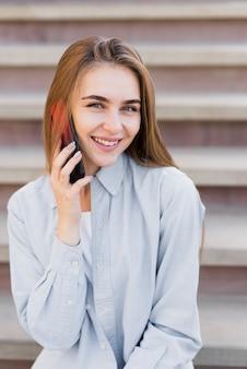Smiling blonde woman talking on phone