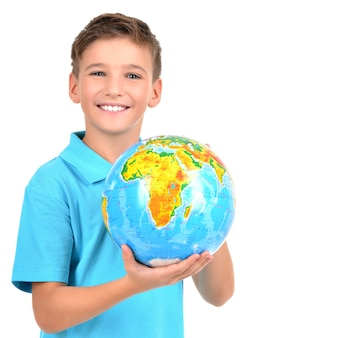 Smiling boy in casual holding globe in hands isolated on white