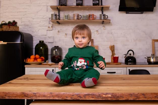 Smiling boy having fun in kitchen at home