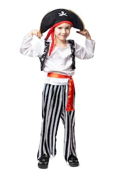 Smiling boy in pirate costume and hat posing showing biceps on white isolated background.