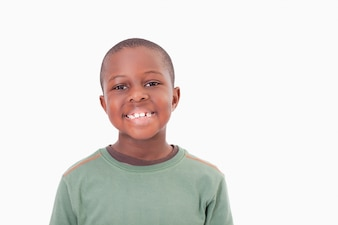 Smiling boy posing against a white a background