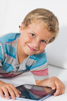 Smiling boy using a tablet