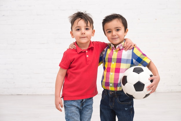 Smiling boys with a football ball