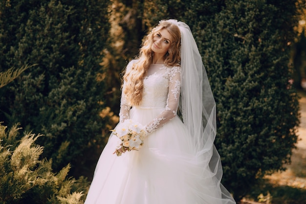Smiling bride with a boiquet