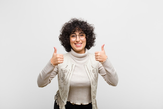 Smiling broadly looking happy, positive, confident and successful, with both thumbs up