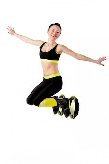 Smiling brunette girl  jumping in a kangoo jumps shoes.