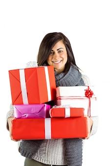Smiling brunette holding many gifts