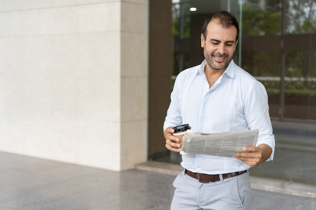 Smiling business leader learning good news