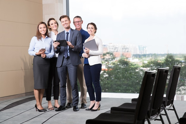 Smiling business team standing in conference room