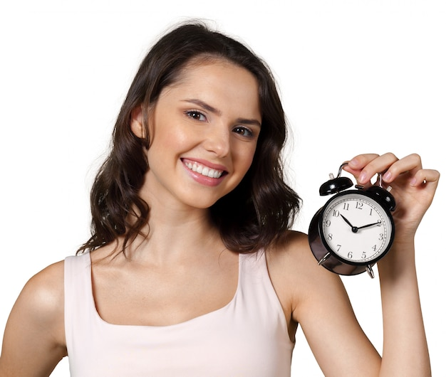 Smiling business woman holding alarm watch