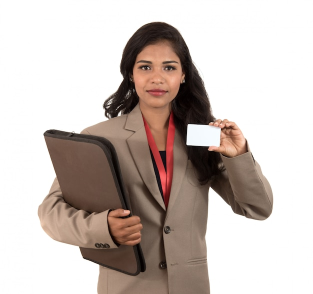 Smiling business woman holding a blank business card or id card over white space