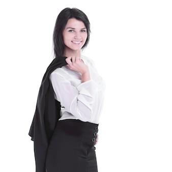 그녀의 어깨 너머로 재킷을 입고 웃는 비즈니스 우먼. 배경에 고립