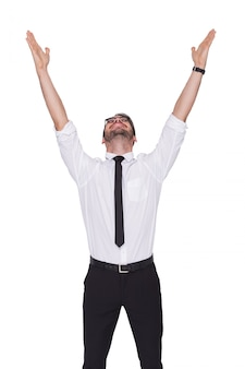 Smiling businessman cheering with his hands up