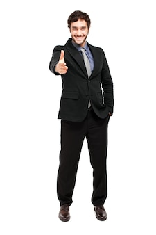 Smiling businessman giving his hand