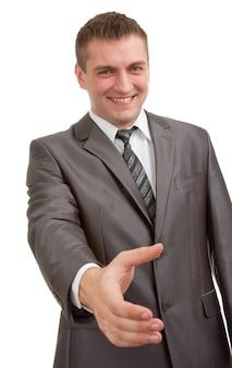 Улыбающийся бизнесмен собирается пожать руку