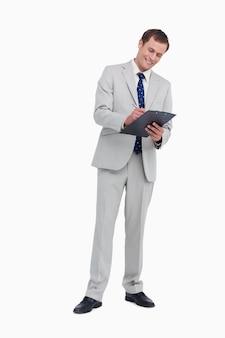 Smiling businessman taking notes