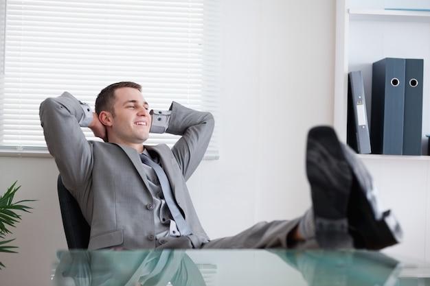 Smiling businessman taking a rest