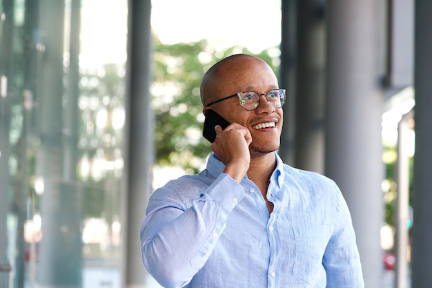 Smiling businessman talking on mobile phone