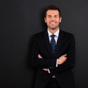 Smiling businessman with arms crossed