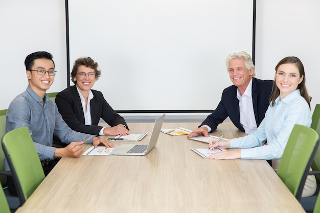 Smiling businesspeople in boardroom at meeting