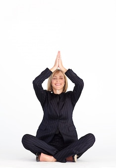 Smiling businesswoman in buddha position